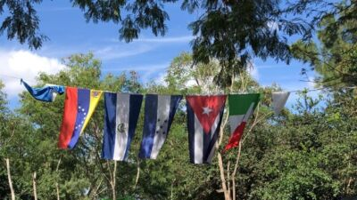 Flags hang in the Matamoros camp representing the home countries of camp residents.